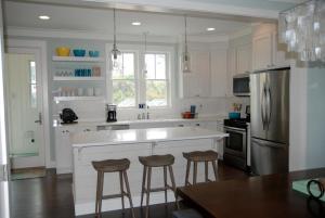 A kitchen or kitchenette at Sandy Side Up Four-Bedroom Home
