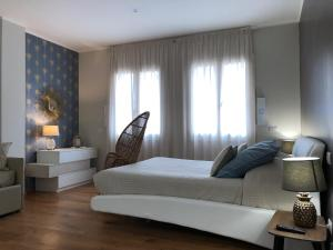 A bed or beds in a room at Le Dimore del Borgo