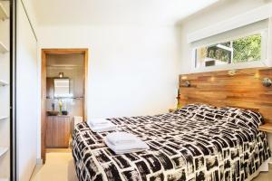 Una cama o camas en una habitación de Mono Ambiente para 4 personas