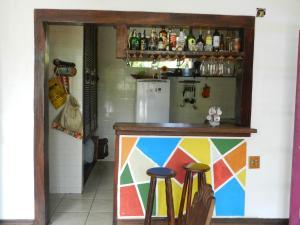 The lounge or bar area at Casa de Vidro na Praia