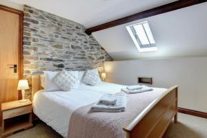 A bed or beds in a room at Canoldy