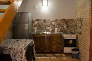 Kuchnia lub aneks kuchenny w obiekcie Duplex Macuco
