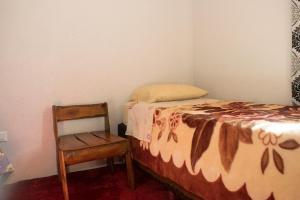 Łóżko lub łóżka w pokoju w obiekcie Duplex Macuco
