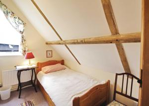 A bed or beds in a room at The Granary VIII