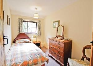 A bed or beds in a room at The Stables V
