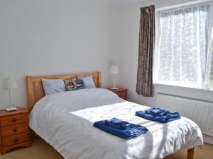 A bed or beds in a room at Greengage