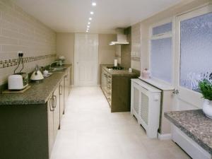 Küche/Küchenzeile in der Unterkunft Cedar Lodge
