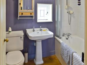 A bathroom at Ocean Cottage