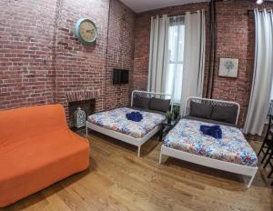 A bed or beds in a room at New York Apartments