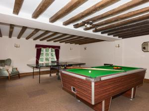A pool table at Chatcull Old Hall