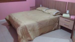 A bed or beds in a room at Casa em Canela