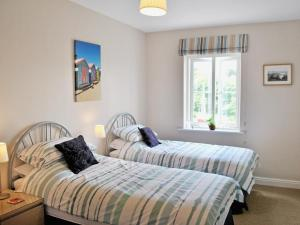 A bed or beds in a room at The Slipway