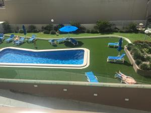 A view of the pool at The Sands Holiday Apartments or nearby