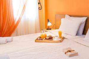 Voodi või voodid majutusasutuse Kostis Villas toas