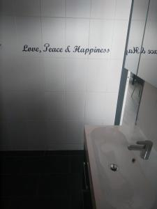Een badkamer bij Slapen in Dordrecht