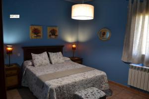 Cama o camas de una habitación en Apartamentos Rurales Natura