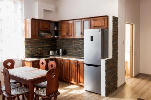 A kitchen or kitchenette at Apartamenty Eden