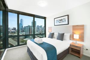 Кровать или кровати в номере City Tempo - MP Deluxe