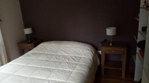 Una cama o camas en una habitación de Casa en Llao Llao