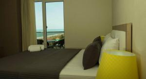 Кровать или кровати в номере Panorama Batumi Apartments