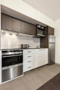 A kitchen or kitchenette at Quest at Sydney Olympic Park