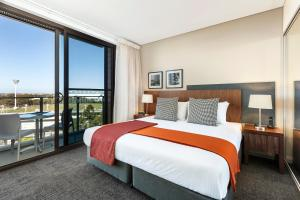 A bed or beds in a room at Quest at Sydney Olympic Park