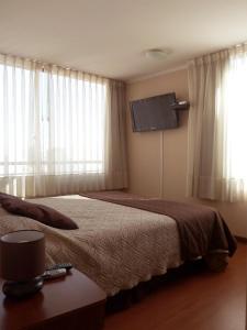 Cama o camas de una habitación en Personal Aparts Bellas Artes