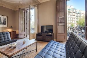 A television and/or entertainment center at Habitat Apartments Barcelona Balconies