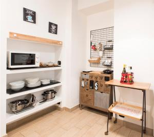 A kitchen or kitchenette at Il salottino in via Carlo Alberto