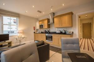 A kitchen or kitchenette at Waterfront Apartments