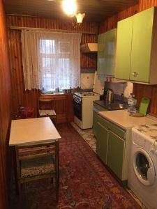A kitchen or kitchenette at квартира под ключ