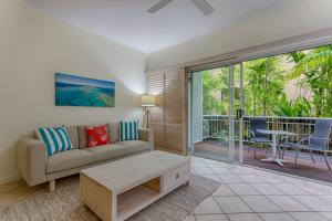 A seating area at Macrossan House Boutique Holiday Apartments