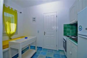 A kitchen or kitchenette at Ethereal Apartments