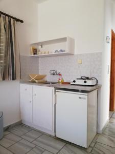 A kitchen or kitchenette at Poseidonio of Paros