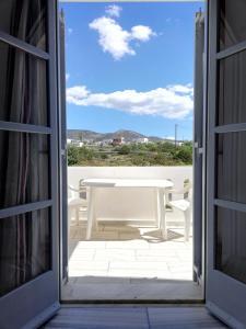 A balcony or terrace at Poseidonio of Paros