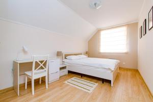 A bed or beds in a room at Zvenigorod cottage Suponevo