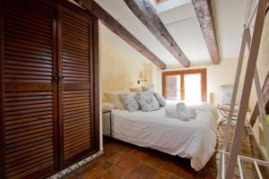 Ein Bett oder Betten in einem Zimmer der Unterkunft Luxury Apartment Puerta de Alcalá and Serrano Street
