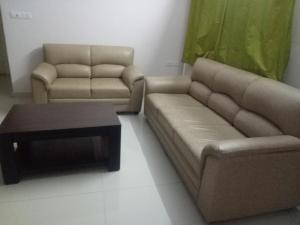 A seating area at Arra Suites