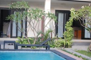 The swimming pool at or near Maha Rama Suite
