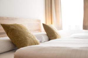 Ein Bett oder Betten in einem Zimmer der Unterkunft Sauerweingut