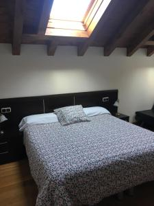 A bed or beds in a room at Apartamentos Irati