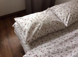 Кровать или кровати в номере Apartments on Lermontova 3