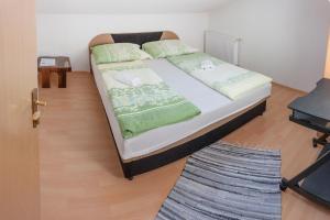 Postel nebo postele na pokoji v ubytování Apartments Aqua Resa