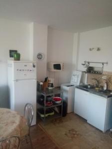 O bucătărie sau chicinetă la Apartment Neptun