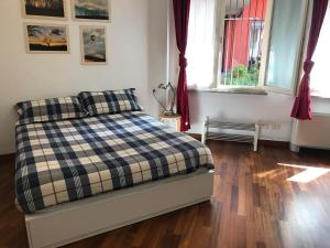 A bed or beds in a room at Appartamento Ampere