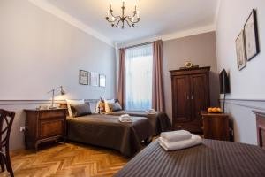 A bed or beds in a room at Scharffenberg Apartments Main Square
