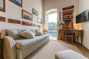 A seating area at ALTIDO Stylish Seaview Apartment in Portofino