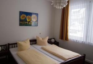 Ein Bett oder Betten in einem Zimmer der Unterkunft Aparthotel Jägerhaus