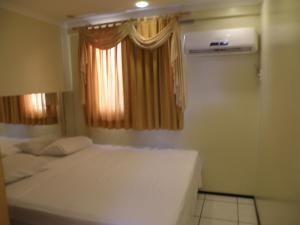 A bed or beds in a room at Porto de Iracema Apartment 2 Quartos/ 2 Bedrooms)