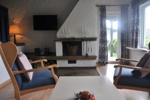 A seating area at Eifel Landhaus Seeblick